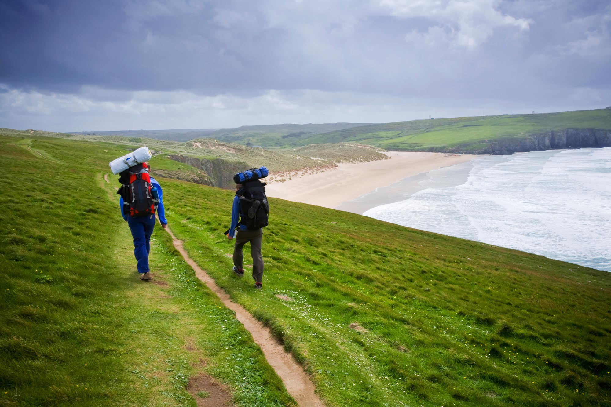 People walking the coastal path with views of the sea