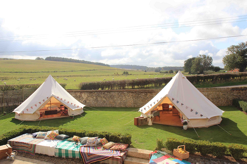 Large luxury tents with views of the countryside