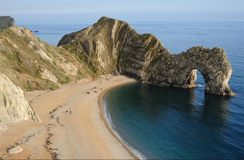 Durdle Door landmark - a natural limestone arch sitting in the sea