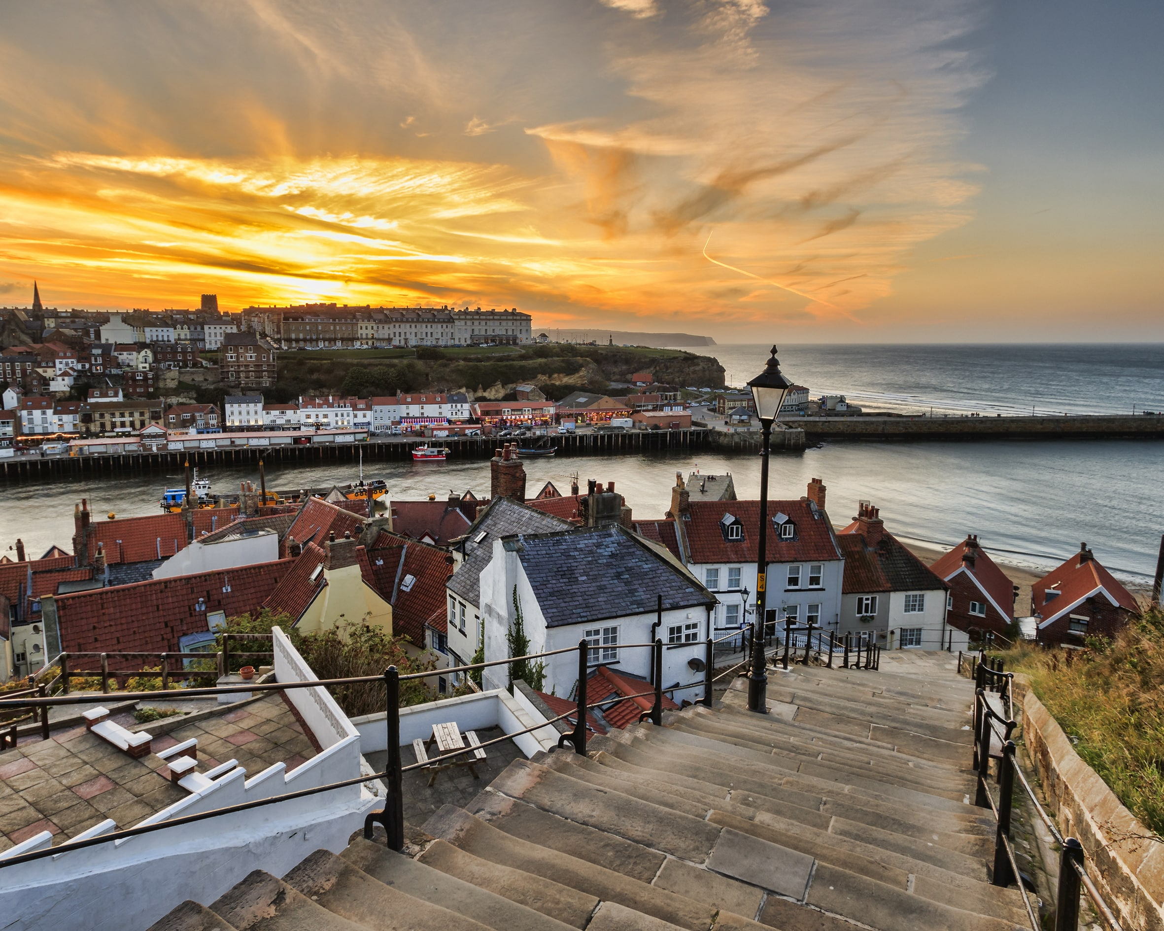 Steps down to Whitby seaside at sunset