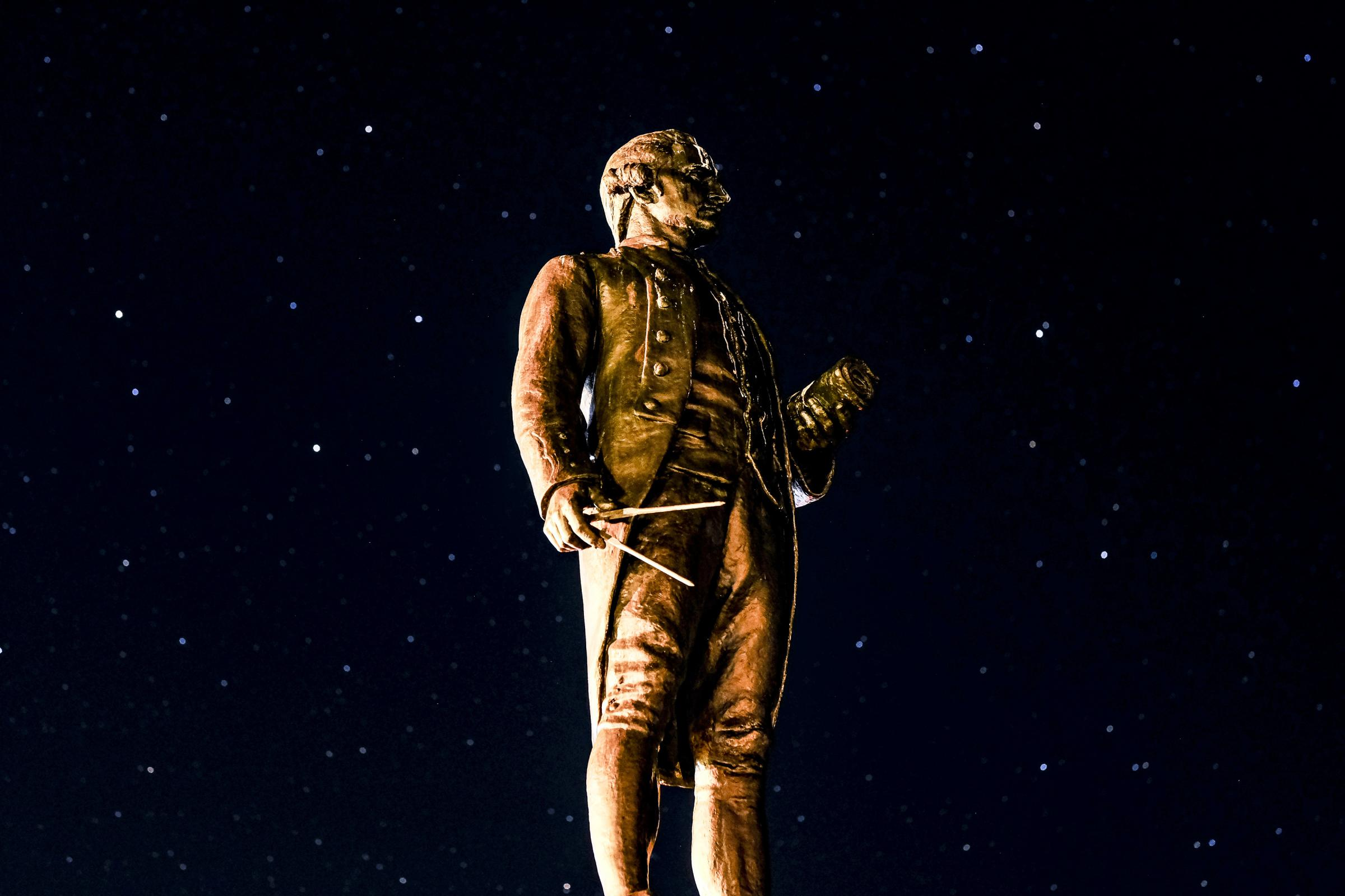 A starry sky behind the Captain Cook monument on the West Cliff at Whitby