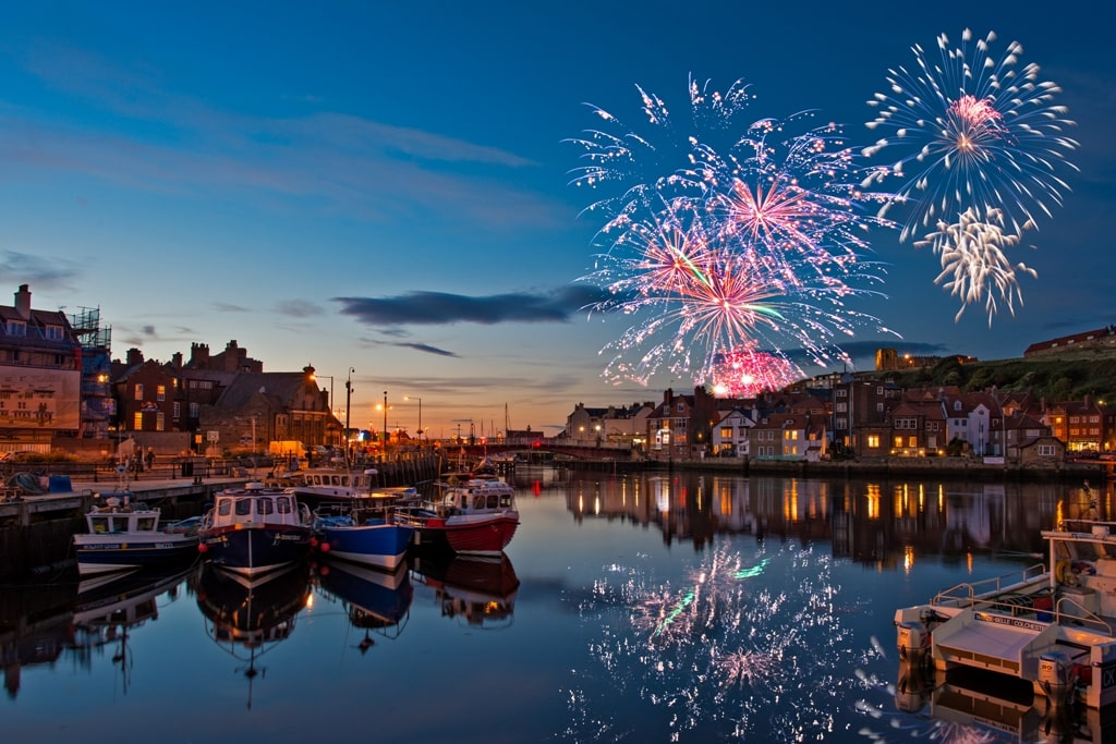 Fireworks and boat on the harbour at Whitby Regatta, Yorkshire