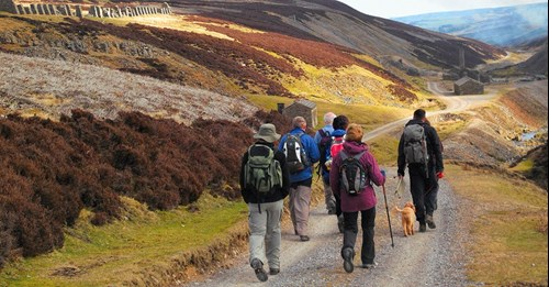 Group of people walking through the Yorkshire Dales National Park
