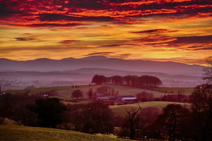 Red, orange and purple sunset in the Cumbrian countryside