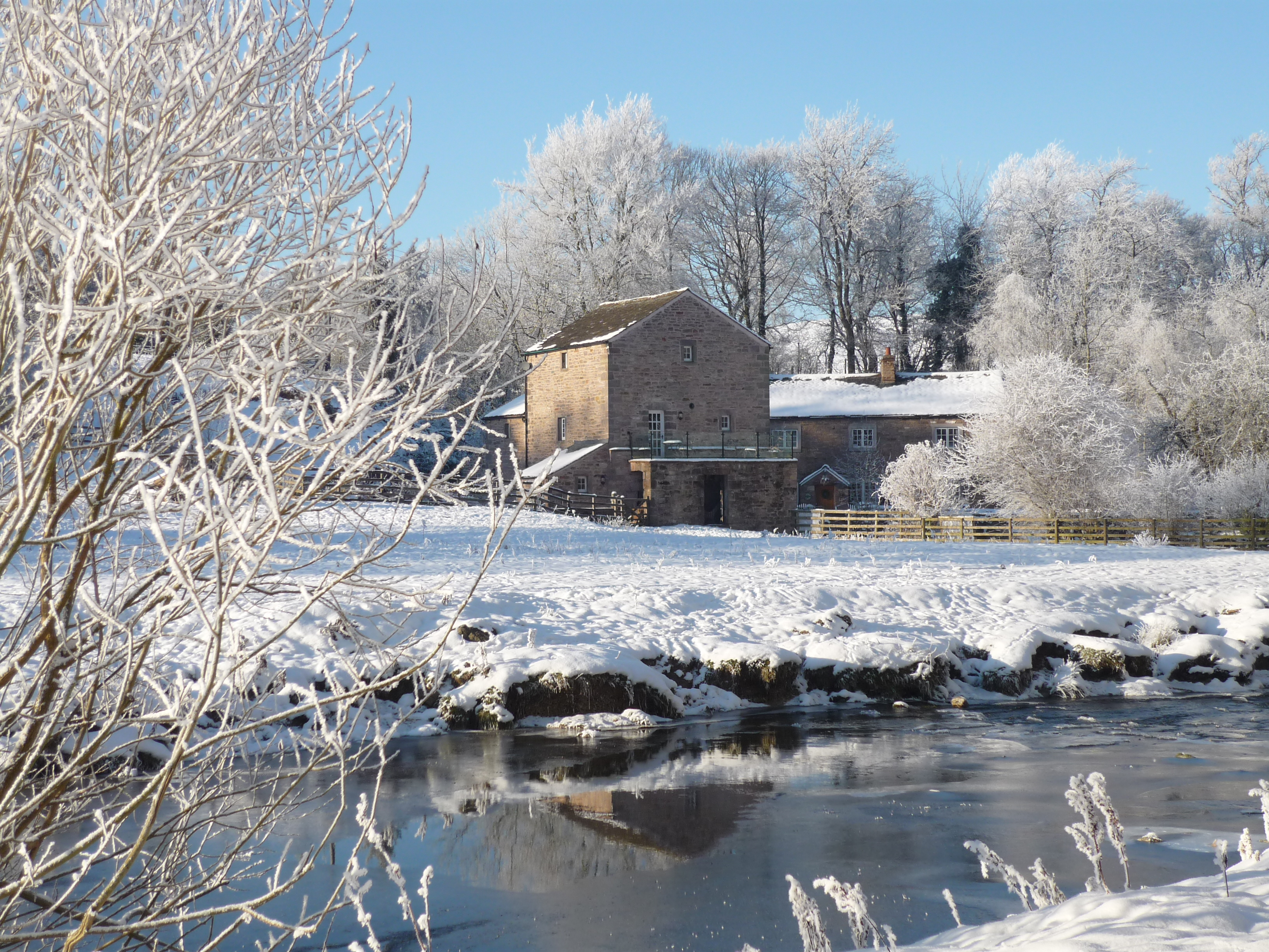 Holiday cottage in the snow by a lake
