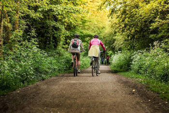 Two people cycling through the Peak District